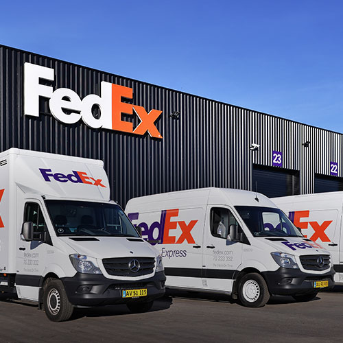 Fedex trucks at a shipping facility