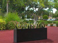 Black rectangular planter in a garden