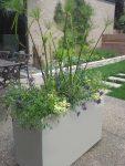 White planter on a patio