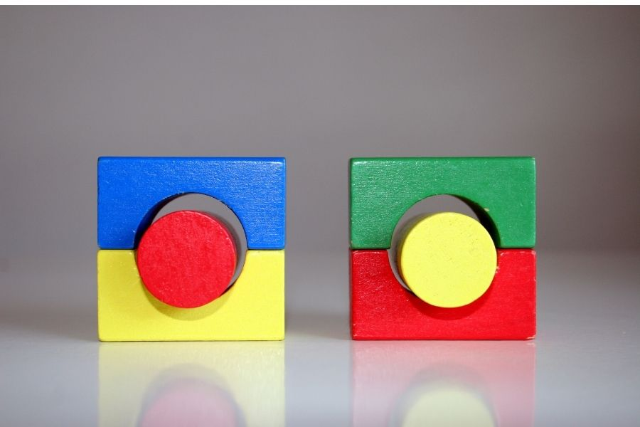 Wooden blocks with complementary colors on the table.